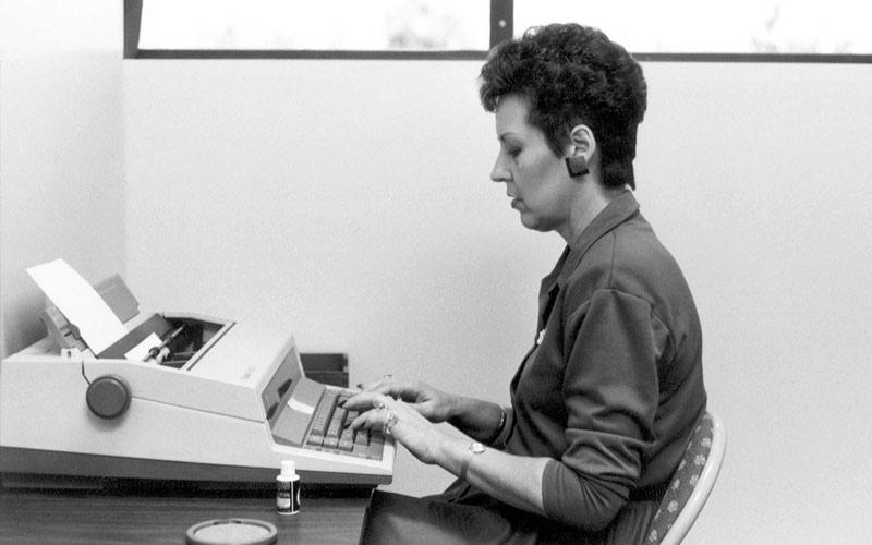 Joyce Meyer typing on a typewriter