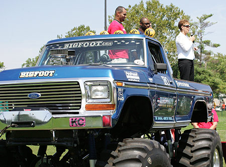 Joyce standing on a monster truck with Albert Pujols at a St. Louis Dream Center event