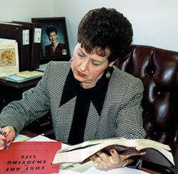 Joyce works on her teaching notes for a conference in 1997.